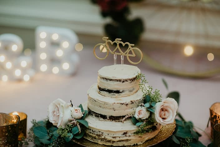 Naked wedding cake decorated with quicksand roses, astilbe and eucalyptus.