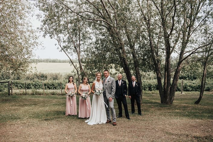 WEdding party with blush in the outdoors