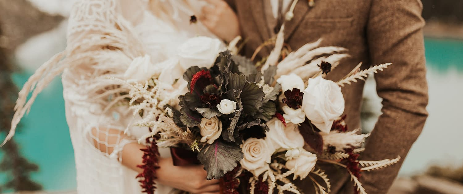 Moraine Lake Elopement Styled Shoot - Pampas grass bouquet made with ivory roses, red hanging amaranthus, dried lunaria and ornamental kale