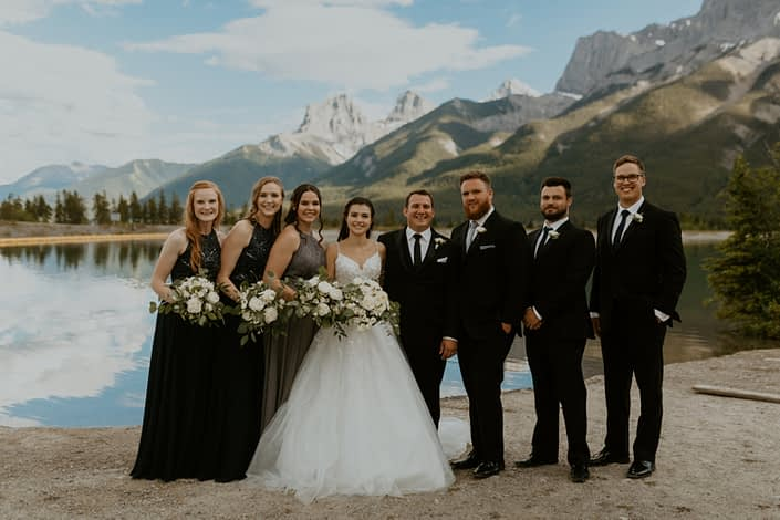 White rural elegance bridal party; navy, charcoal, black and white; white bouquets; white boutonnieres