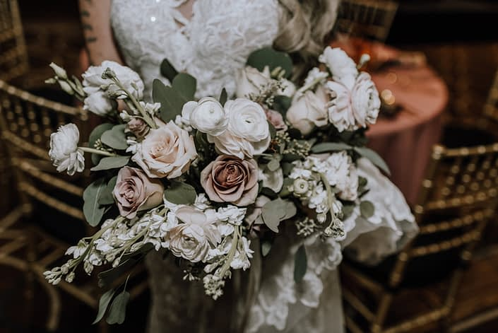Cambridge Bridal Show 2020 - Bridal bouquet of blush and ivory roses with greenery and trailing ribbons.