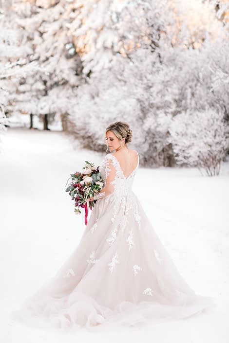 Blush and burgundy bouquet in a snow covered winter wonderland