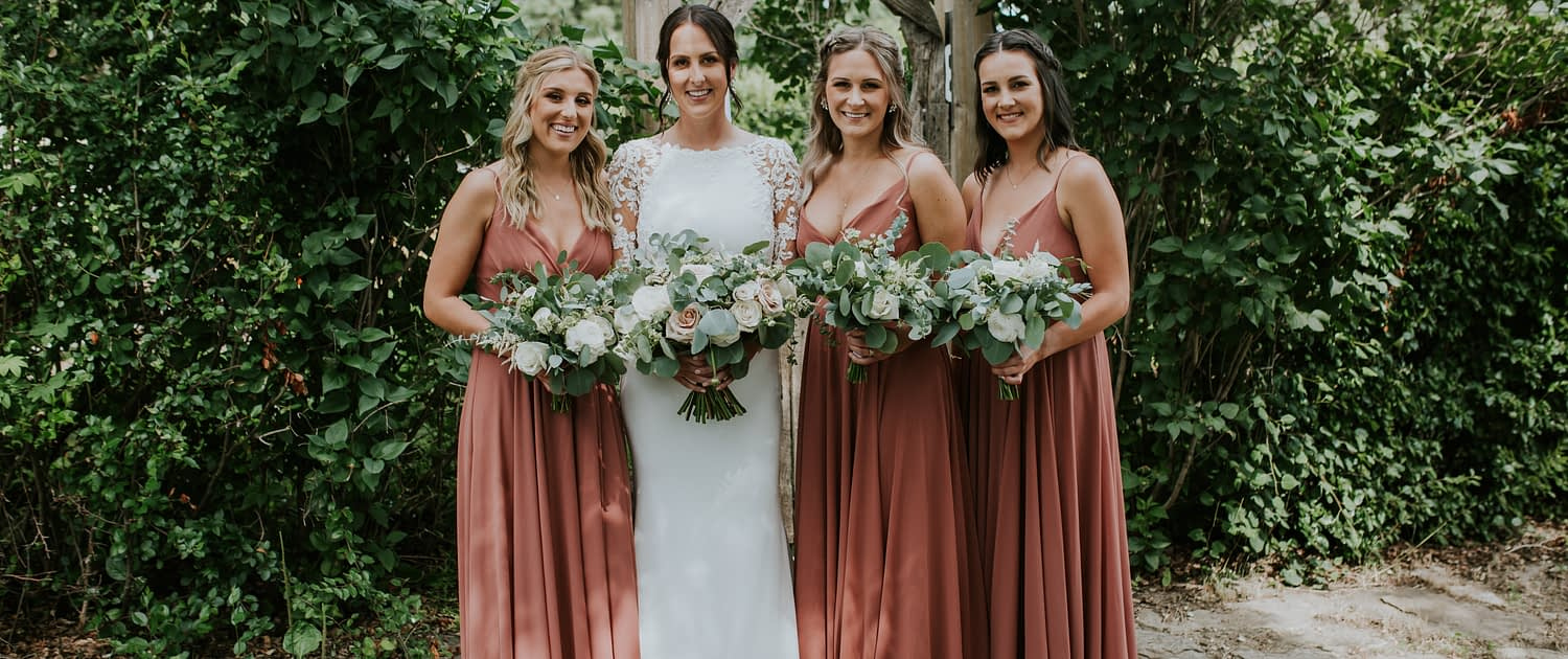 Rusty rose wedding - Bride with bridesmaids wearing rusty rose dresses