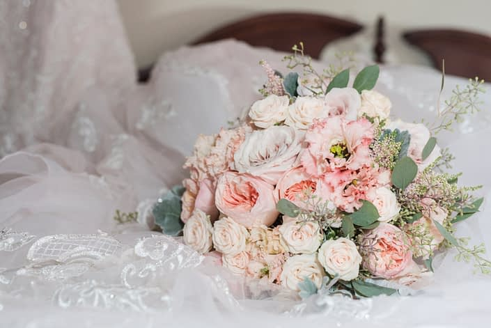 Pink blush bridal bouquet for Megan and Steven's Rustic Pastel Wedding made of blush pink flowers including Juliet Garden Roses, apricot lisianthus, astilbe, Jana spray roses, quicksand roses, dusty miller and eucalyptus greenery.
