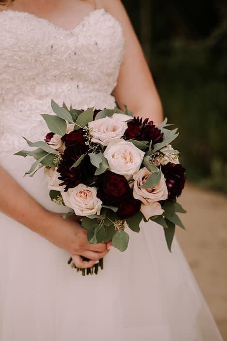 Tamara's Rustic Chic Burgundy and Blush Bridal Bouquet featuring burgundy dahlias, White O'hara Garden roses, Black Baccara roses, quicksand roses and seeded eucalyptus.