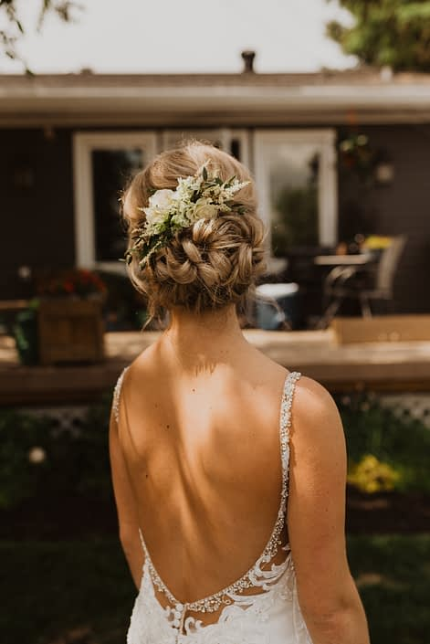 Bridal hair flowers designed with white lisianthus, spray roses, astilbe, and a touch of grey toned greenery.