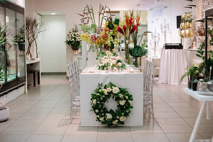 Calyx Floral Design Grand Opening front entrance with tropical flowers and wreath