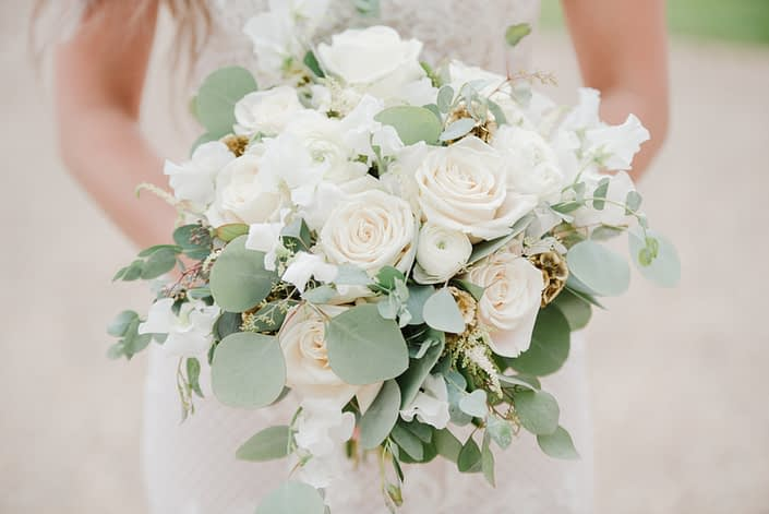Natural White and green wedding bridal bouquet designed with white astilbe, ranunculus, Tibet roses, sweet peas, gold scabiosa pods and eucalyptus