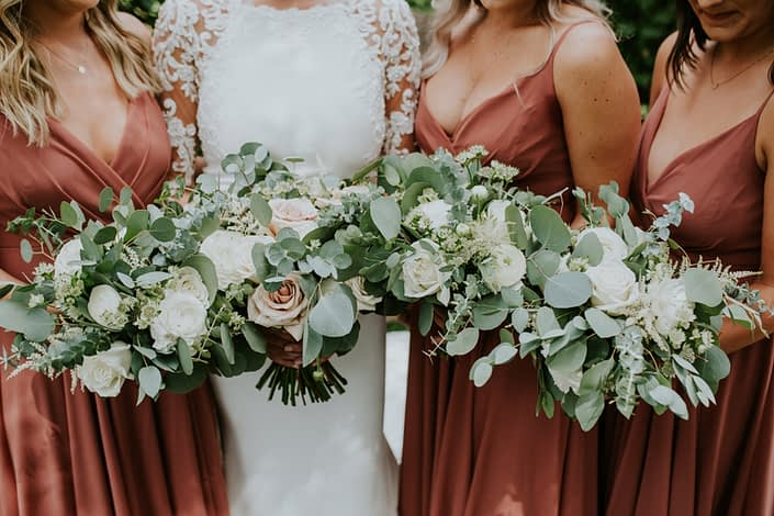 White and rusty rose bouquets for Brandi and Ryley's rusty rose wedding; flowers include astilbe, astrantia, ranunculus, roses,