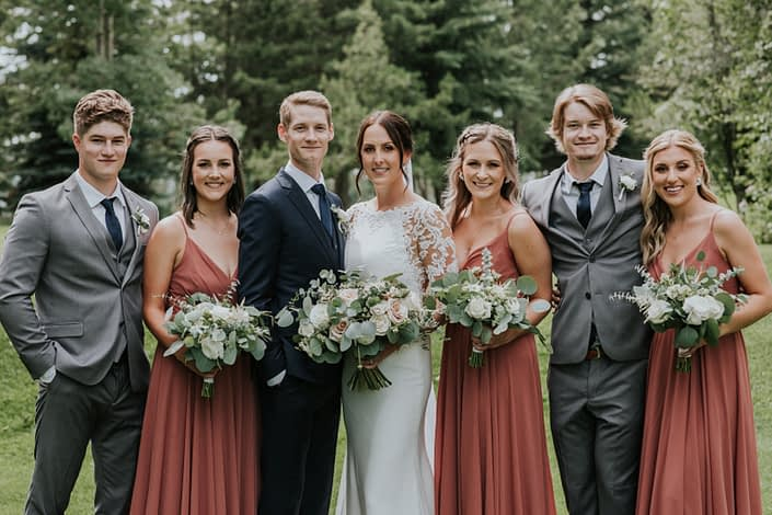 Rusty Rose Wedding bridal party with bouquets and boutonnieres