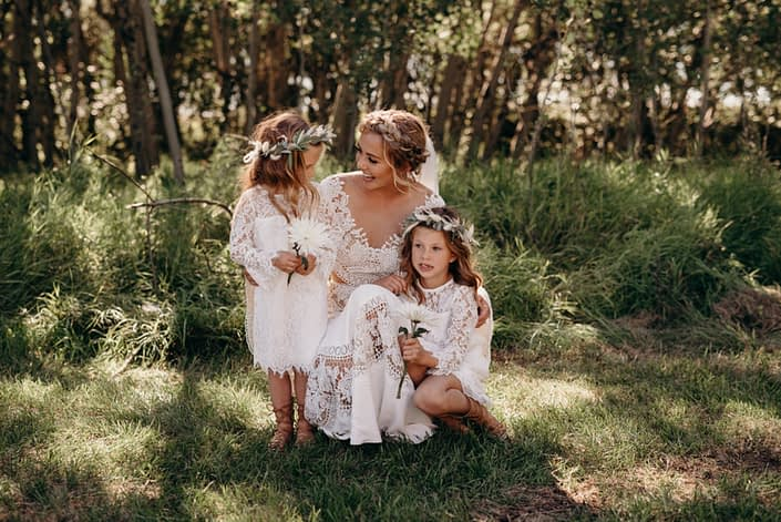 Bride with flower girls wearing flower crowns made of eucalyptus, bleached bracken fern, bunny tail and pampas grass