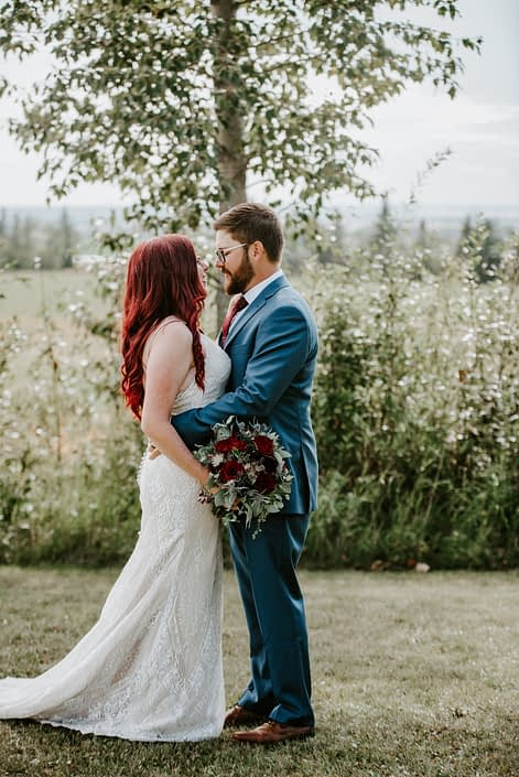 Hailey and Brandon with burgundy and royal blue bridal bouquet