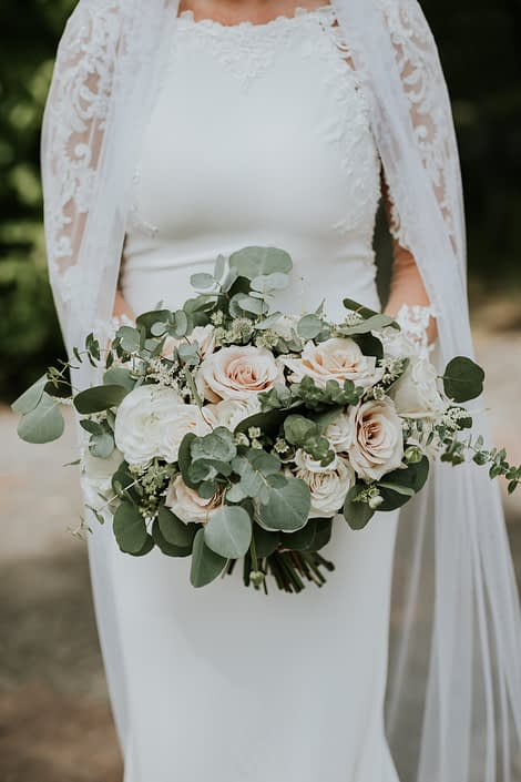 Rusty Rose Wedding bridal bouquet designed with cappuccino roses, playa blanca roses, astilbe, astrantia, ranunculus and spray roses with a mixed variety of eucalyptus greenery