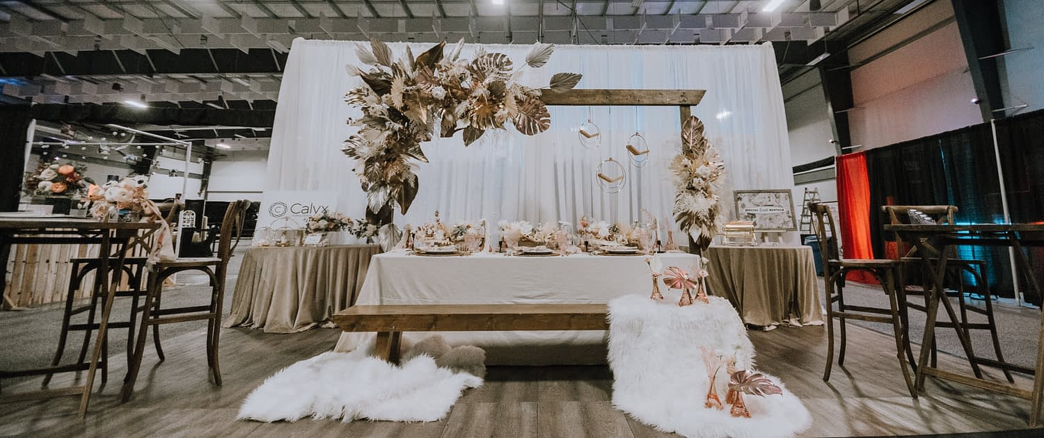With This Ring Bridal Gala 2020 booth with wood, metallic, white, cream, ivory, and blush pink accents
