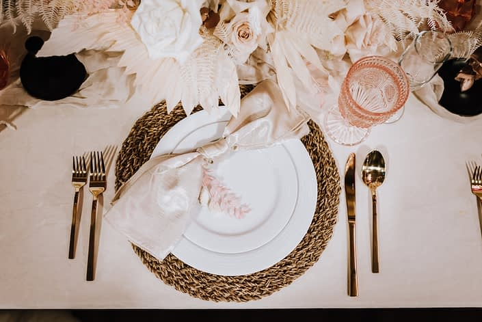 Table setting at the With This RIng Bridal Gala 2020 booth featuring metallic, wood, pink, ivory, cream and white tones and textures.