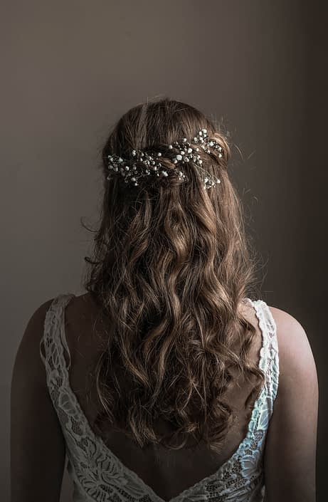 Pink Vintage Photoshoot - Silver hairpiece with babies breath flowers tucked into her hair.