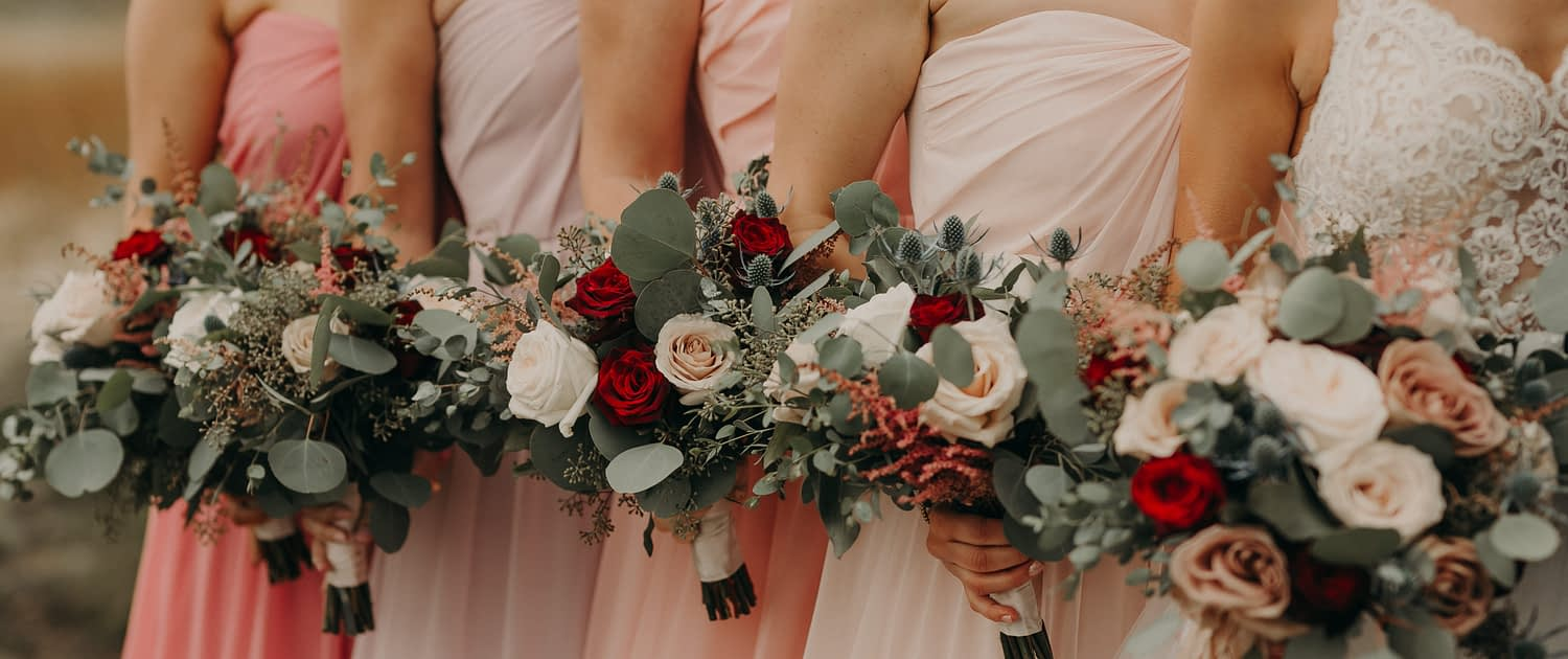 Blush and Red and White Wedding bridal party with ombre blush dresses and bouquets with red roses and white o'hara garden roses and pink astilbe and quicksand roses and navy eryngium and mixed eucalyptus