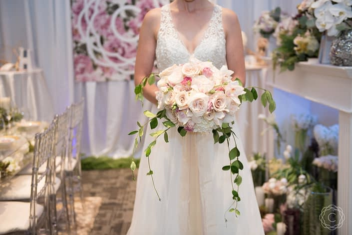 Compact-and-Elegant-Bridal-Bouquet-of-Mixed-Roses-with-Jasmine-Vine-Collar
