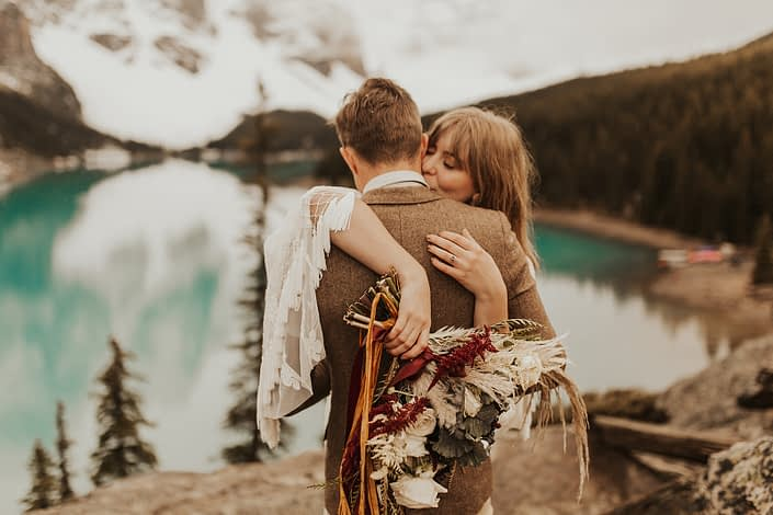Moraine Lake Elopement Styled Shoot - Pampas grass bouquet made with ivory roses, red hanging amaranthus and ornamental kale tied with trailing ribbon.