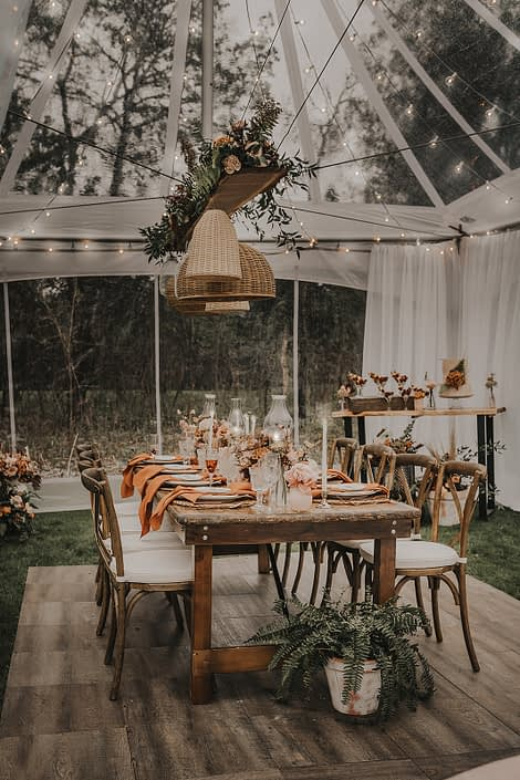 Small, intimate tent wedding with natural elements