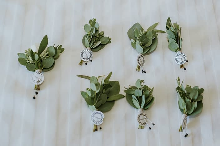 Eucalyptus boutonnieres for Brooke and Levi's Rustic Chic Blush Wedding