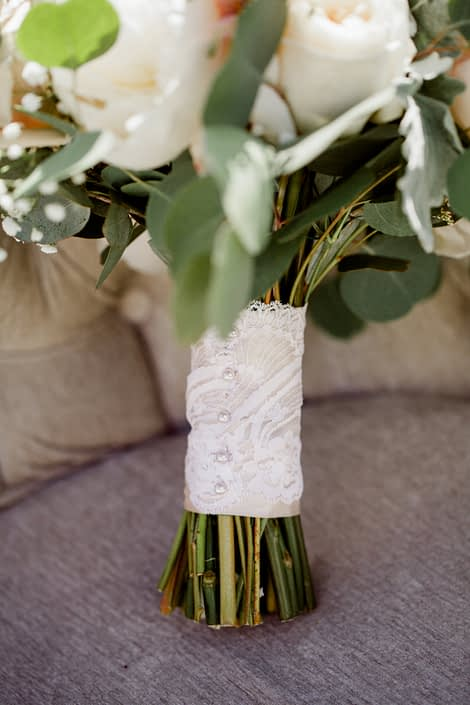 Cream and Blush Vintage Chic bridal bouquet handle wrapped with blush satin and an ivory lace overlay with pearl pins.
