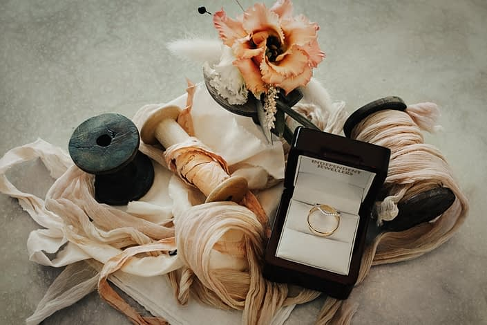 Peach boutonniere for Boho Drumheller Engagement designed with lisianthus and bunny tail
