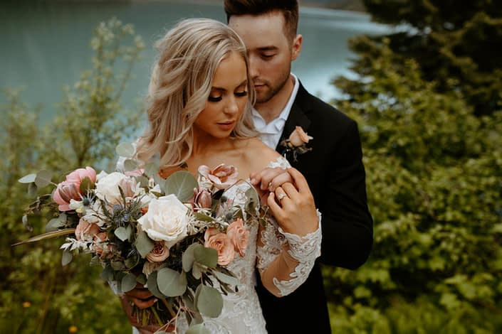 Bride and groom with blush pink and white boutonniere and bouquet designed with roses, tulips, peonies, eryngium, bleached italian ruscus and eucalyptus greenery