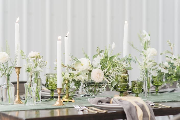 White and green tablescape with gold accents; floral arrangements designed with ranunculus, poppies, astilbe, bunny tail, sweet peas, snap dragons and greenery