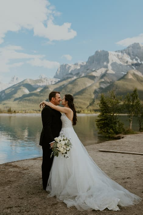 Rural elegance bride and groom in the mountains with white bridal bouquet