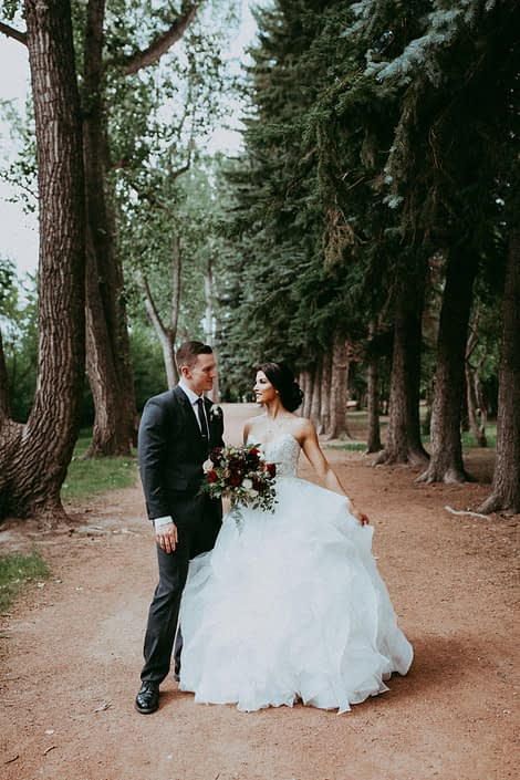 Bride and Groom Burgundy and Dark Grey Wedding with bridal bouquet designed with burgundy dahlias, hearts garden roses, black pearl lisianthus, amnesia roses, ivory spray roses, plumosa and eucalyptus greenery