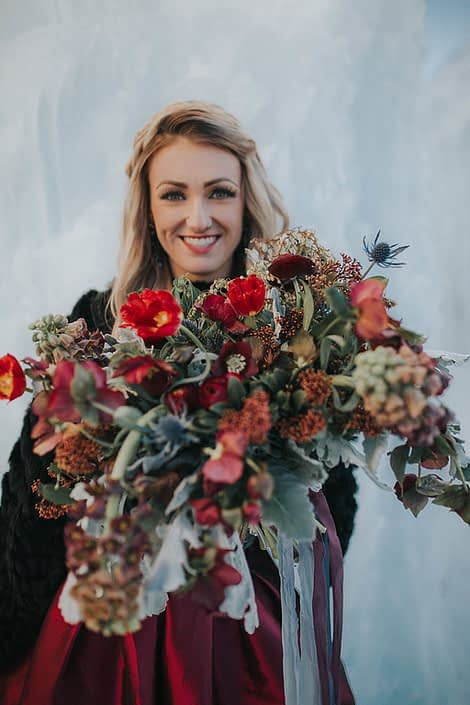 Engagement Photos with bouquet made with frittilaria, tulips and skimmia