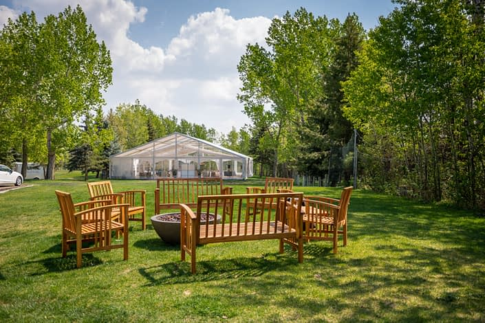 Firepit seating at hilltop wedding center with clearspan wedding tent
