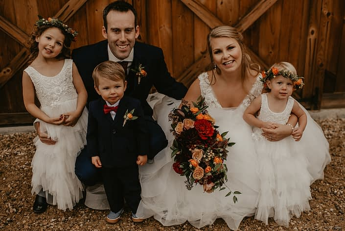 Bride and groom, Hayley and James, rustic fall wedding flower girls and ring bearer with flower crowns and boutonniere.
