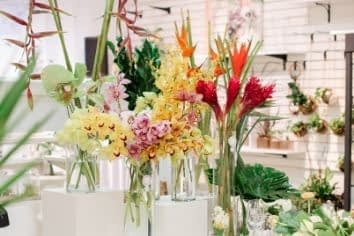 fresh tropical flowers, heliconia, ginger, birds of paradise and cymbidium orchids in bright colors