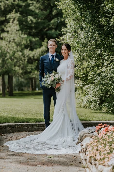 Brandi and Ryley with white, ivory and rusty rose bridal bouquet