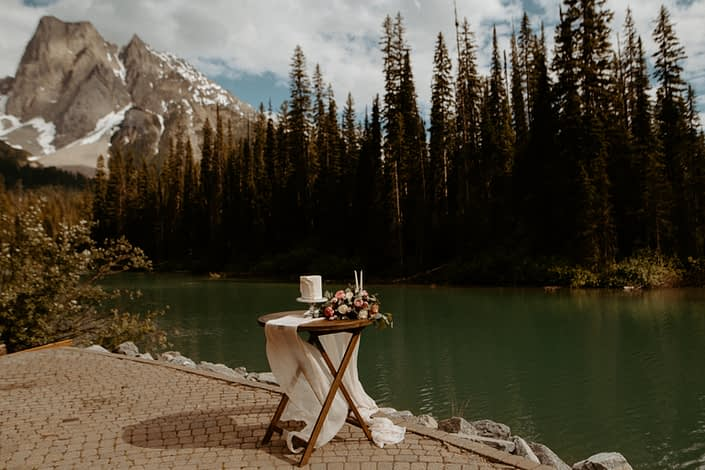Emerald Lake Photoshoot cake table with bouquet of flowers