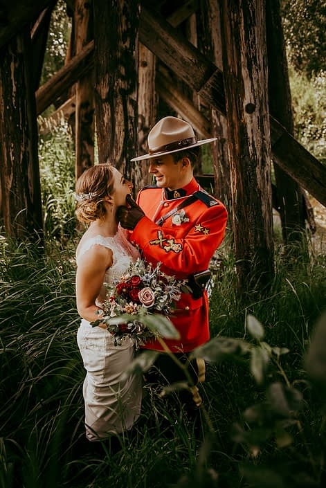 bride and groom Tanya and Sean RCMP wedding - with bridal bouquet designed with black baccara roses, amnesia roses, navy eryngium, burgundy dahlias, rose gold succulents and eucalyptus