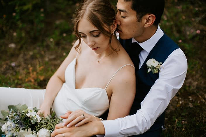 Bride and groom with ranunculus boutonniere and bridal bouquet
