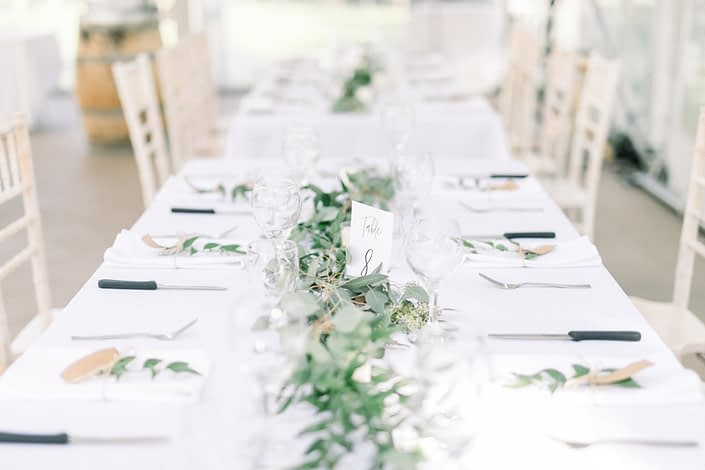 Simple and timeless fresh greenery garland centrepiece.