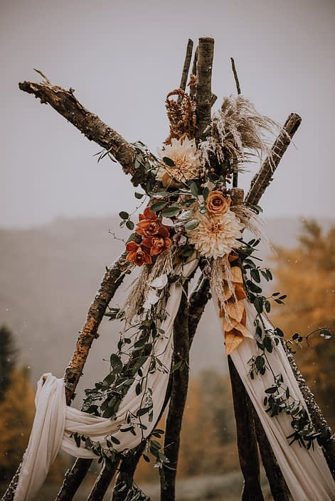 Down the Aisle fall styled shoot tee pee flowers including dahlias, orchids, roses and pampas grass