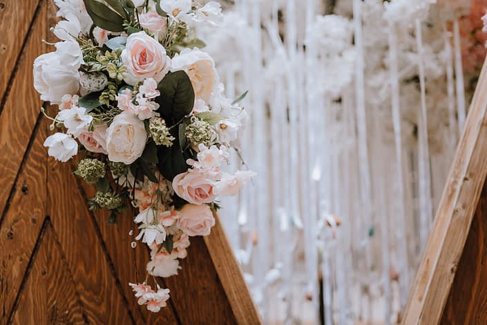 White, peach and pink permanent botanicals on a wooden backdrop