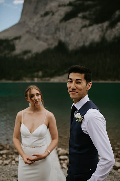 Bride and groom with ranunculus boutonniere