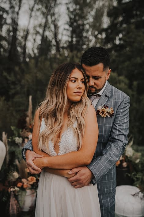 Modern Boho Couple with rusty terracotta boutonniere
