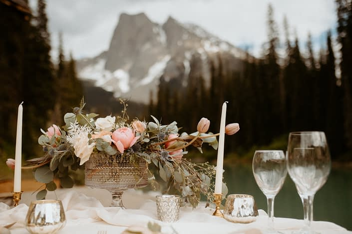 Emerald Lake Photoshoot 2020 - sweetheart table centrepiece designed with pink peonies, Playa Blanca roses, blue eryngium, toffee roses, tulips, bleached Italian ruscus and eucalyptus greenery