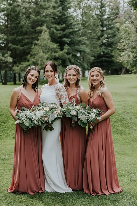 Rusty Rose Wedding at Hilltop; bride and bridesmaids with bouquets