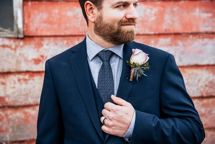 Mauve and Navy boutonniere designed with amnesia rose, eryngium and eucalyptus