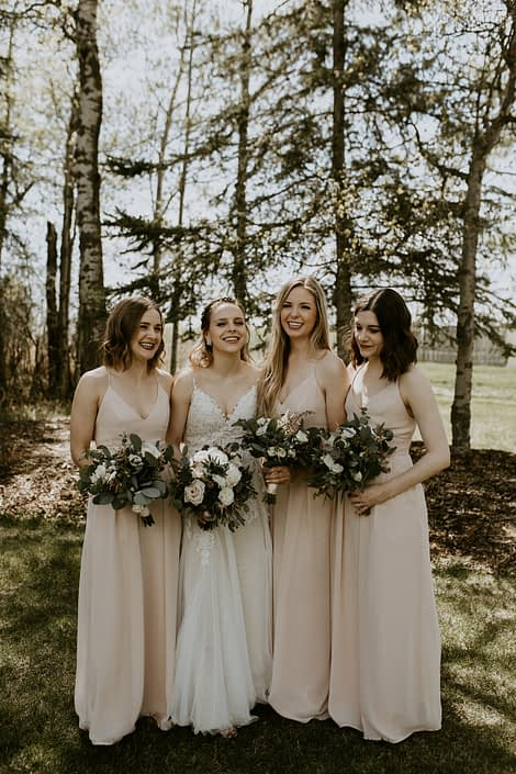 Blush, white and burgundy Bride and bridesmaids at Pine and Pond with bouquets