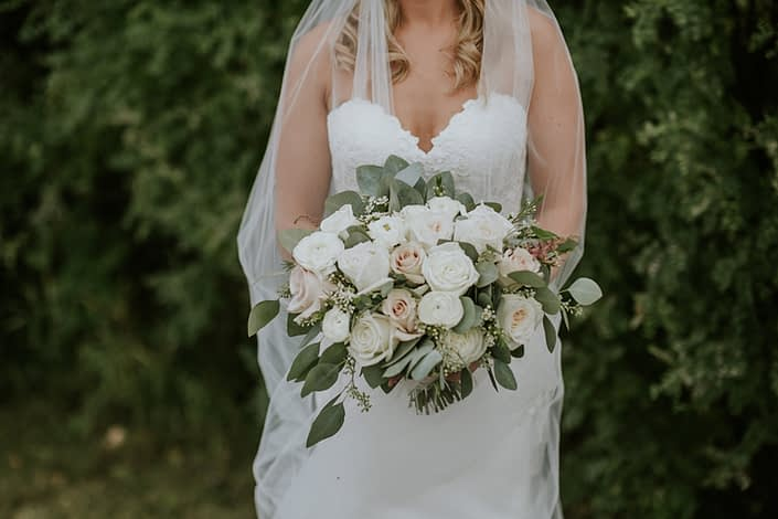 Brooke's blush and ivory bridal bouquet made of white o'hara garden roses, quicksand roses, playa blanca roses, ranunculus, astilbe, wax flower and eucalyptus greenery.