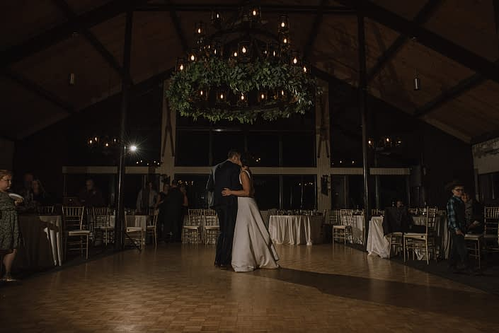bride and groom dancing at Canyon ski resort underneath the chandelier decorated with a stunning mixed eucalyptus greenery garland